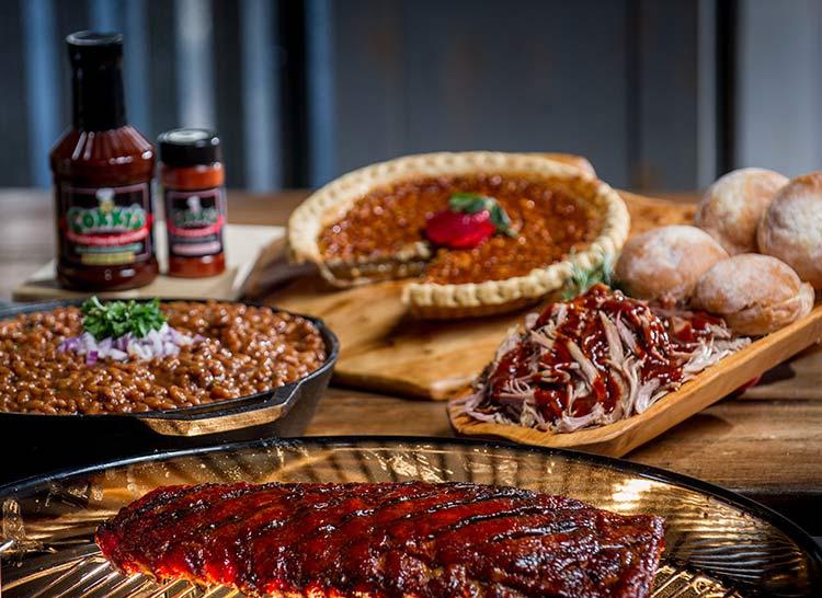 Ultimate Taste of Corky's package including ribs, pulled pork, BBQ baked beans, pie, original BBQ sauce and dry rib seasoning